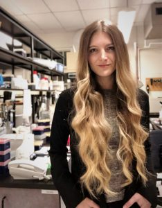 UA alumna Tori Stone poses in her lab at Yale University.